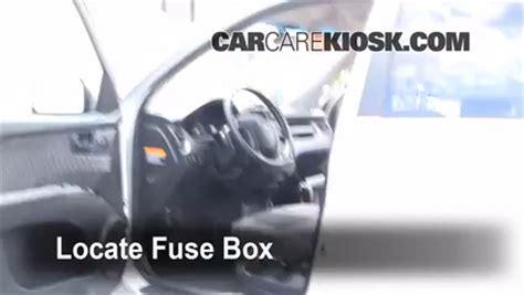 interior fuse box location   kia sportage