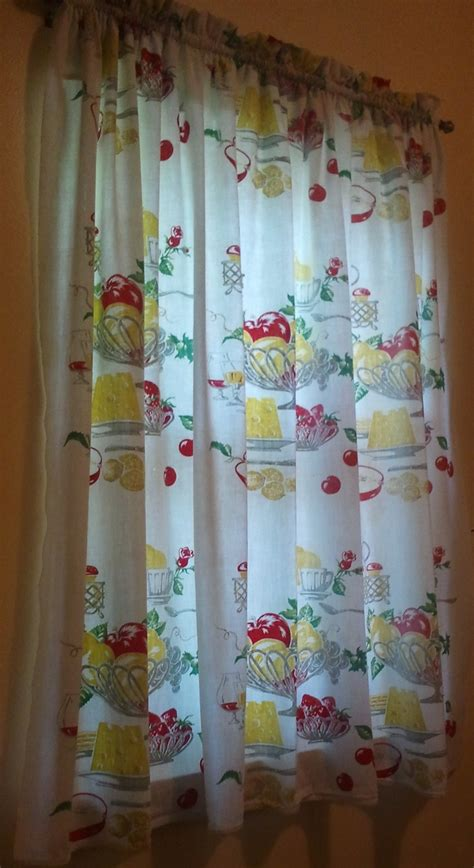 This vintage tablecloth curtain in the laundry room