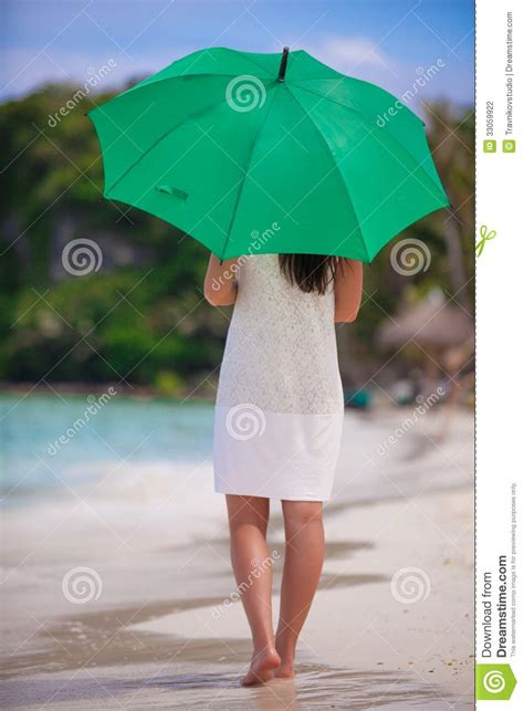 view  young woman  green umbrella  stock