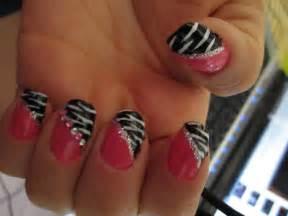Pink and black zebra nail design blue rhinestones