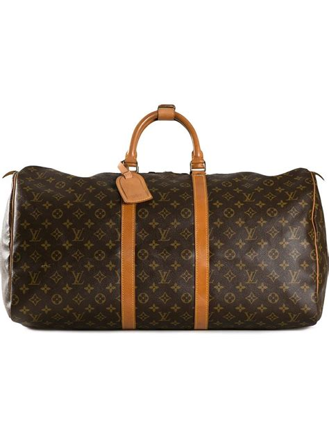 louis vuitton keepall  travel bag  brown lyst