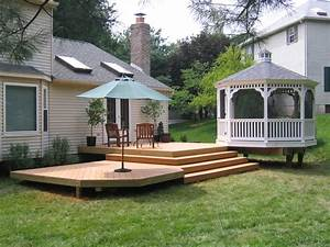 Decks patios fences screened porches skye builders for Patio with deck