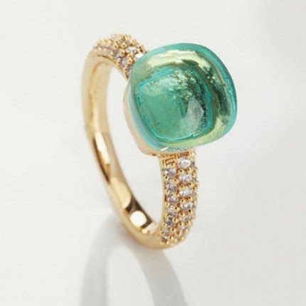 pomellato nudo replica replica pomellato nudo ring in yellow gold with blue topaz