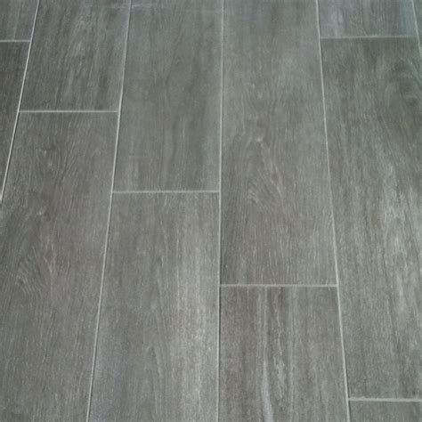 grey tile looks like wood tile floors that look like wood floor pinterest grey wood the floor and grey
