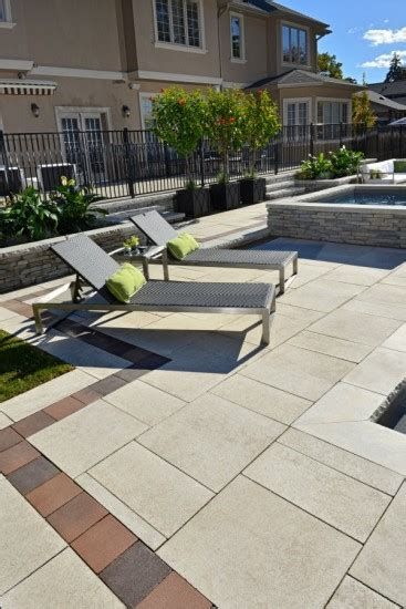 belpasso unilock patio and pool deck by unilock with umbriano and belpasso