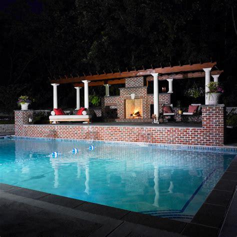 dramatic lighting around pool contemporary pool