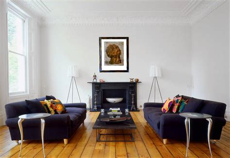 photos of living rooms with two sofas modern living room with crown moldings dueling dark blue