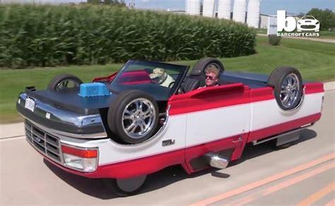mans creates pickup truck  drives upside  video