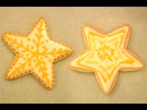 yellow star designs  royal icing   sugar cookie