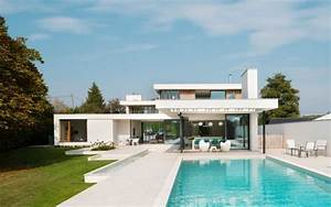 White Volumes and Water Features Defining The River House