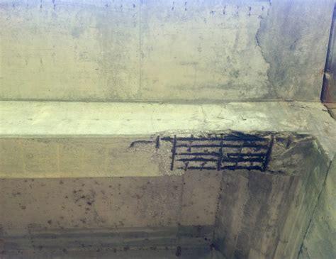 Parking lot concrete support beam carbon fiber repair.   HJ3