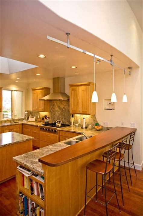 Kitchen with solid wood bar. Curved wall matches curved bar.