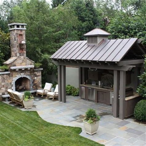 outdoor kitchen roof ahh hopefully one day outdoor kitchen with metal roof blue stone patio and huge exterior