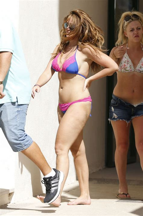 loose womens vicky pattison flaunts curves   strips