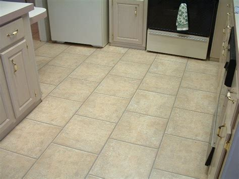 how to put tile floor in kitchen installing laminate tile flooring diy 9817