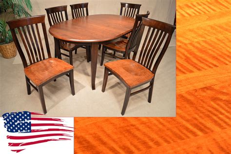 amish oval dining table and tiger maple side chairs