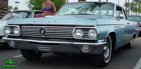 Headlights, Blinkers & Front Chrome Grill Of A 1963 Buick
