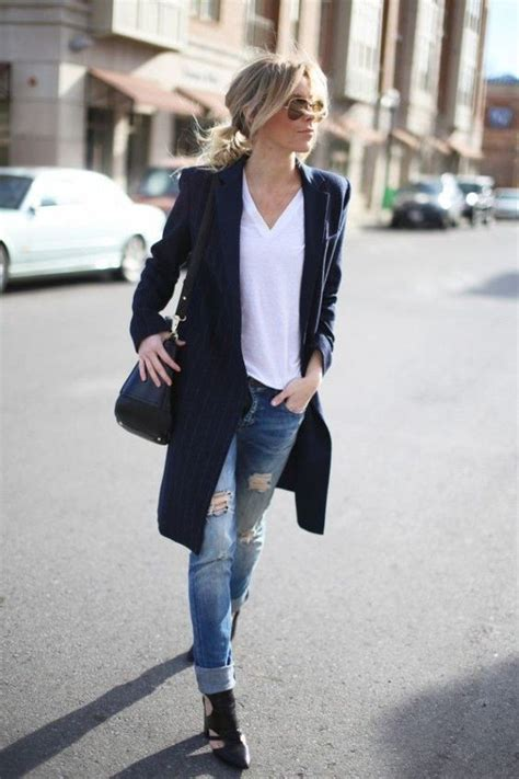 Picture Of ripped jeans a white tee black cutout shoes and a long blazer