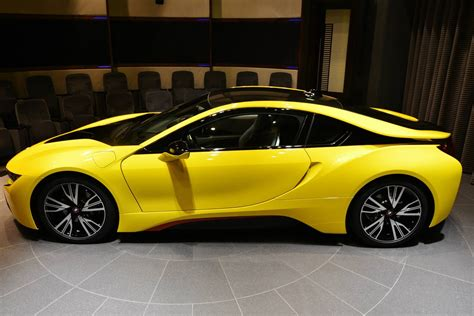 bmw  wears  yellow suit  red accents carscoops