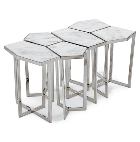 This coffee table has a white, marble table top and sleek, black metal legs. Eastwood Hollywood Regency White Marble Silver Puzzle Coffee Table Set of 6   Kathy Kuo Home