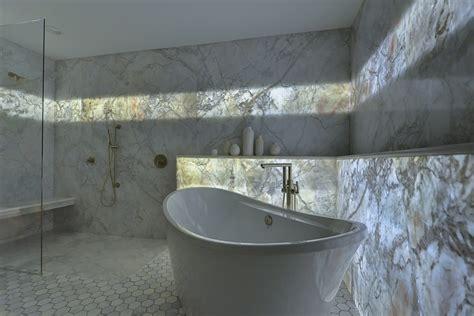 backlit marble wall   guest bath  wow