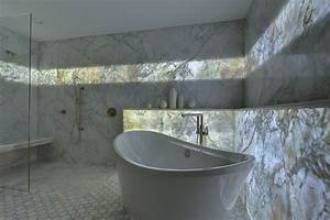 Cost Of Led Lighting A Backlit Marble Wall Gives This Guest Bath Its 39 Wow