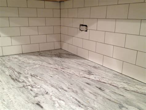 white tile backsplash with white grout kitchen with
