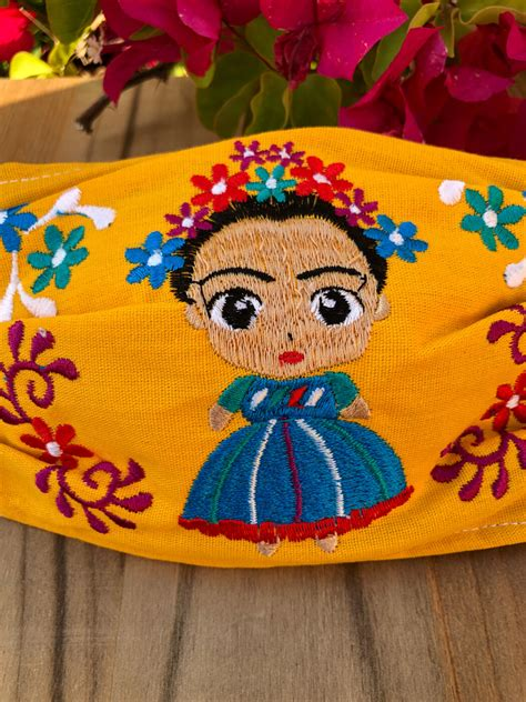 frida mexican embroidered mask yellow ale accessories