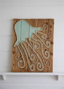 jellyfish trimmed in twine on distressed wood planks for With what kind of paint to use on kitchen cabinets for driftwood seahorse wall art