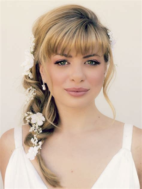 bridal bang hairstyle with braid bun and head pieces ideas