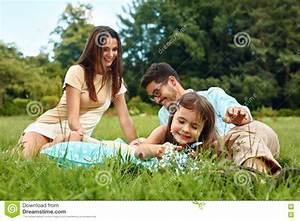 Happy Young Family With Kids Having Picnic Outdoors ...