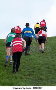 Women running and walking uphill in a cross-country race ...