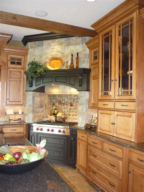 Stone, black painted wood, warm wood tones on cabinetry