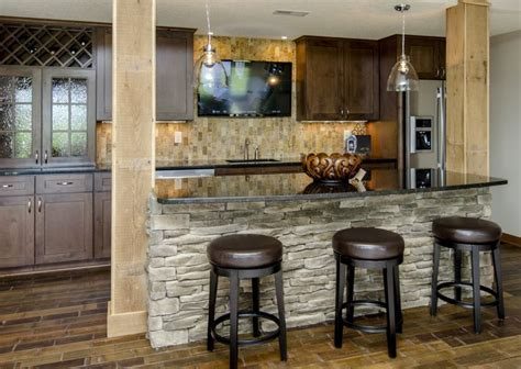 stone on bar front, wine holder, travertine backsplash, tv