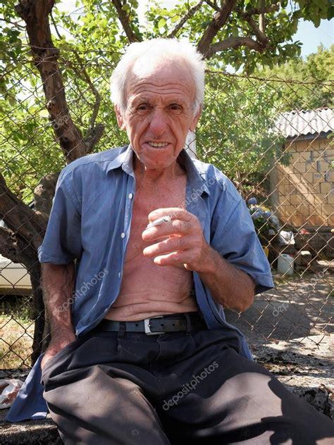 Elderly Farmer Smoking A Hand-rolled Cigarette, Montenegro