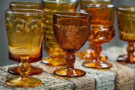 assorted vintage amber colored glass goblets