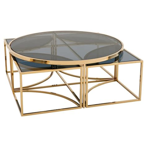 Innovatively designed rounded coffee table featuring a sturdy metal frame and a glass top. Eichholtz Padova Modern Classic Smoked Glass Round Nesting ...