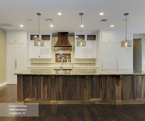 White Cabinets with a Walnut Kitchen Island   MasterBrand