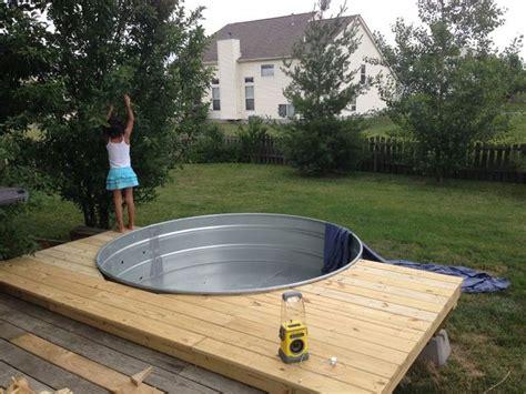 galvanized stock tank turned   simple diy pool eco