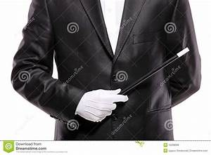 A Magician In A Suit Holding A Magic Wand Royalty Free ...