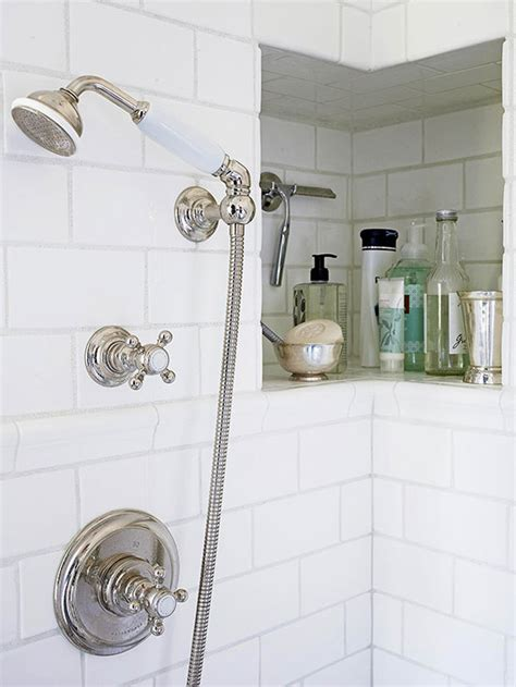 recessed tile lined niche in the bathroom shower provides