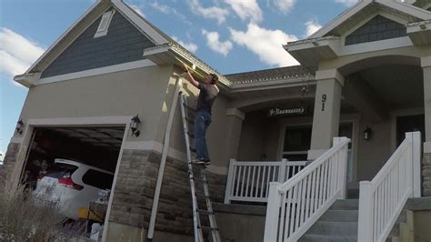putting christmas lights on roof the best way to put up lights diy nils