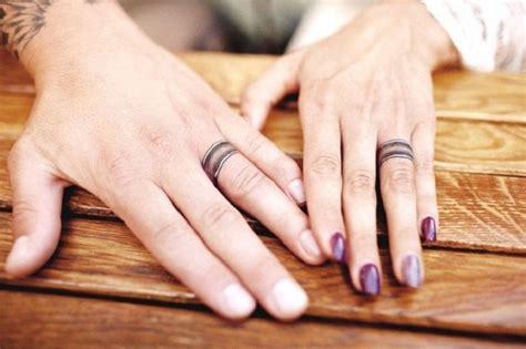 super cool engagement  wedding ring tattoo ideas