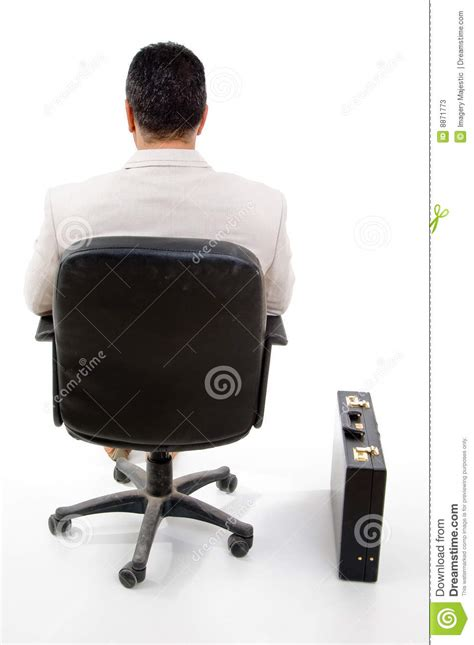 Sitting Chair Price by Back Pose Of Manager Sitting On Chair Stock Photos Image