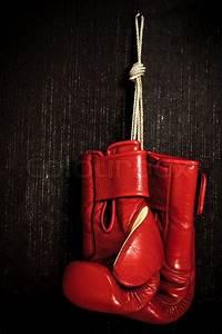 Boxing-glove hanging on grunge background | Stock Photo ...