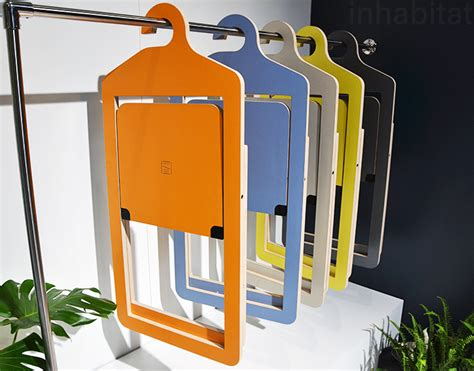 Hanging Folding Chairs On Wall by Malouin S Amazing Umbra Shift Hanging Chairs Are Stored