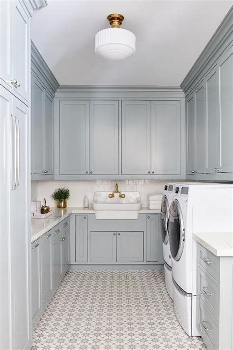 gray laundry room cabinets  white  gray cement