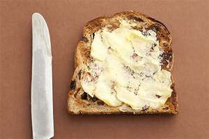 Slice of bread with spreading butter - Free Stock Image
