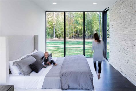 contemporary house surrounded  trees overlooks