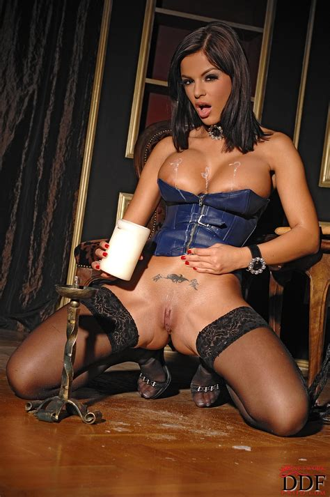 Rampant Brunette In A Corset And Stockings Black Angelika Drips Hot Wax On Her Pussy And Tits